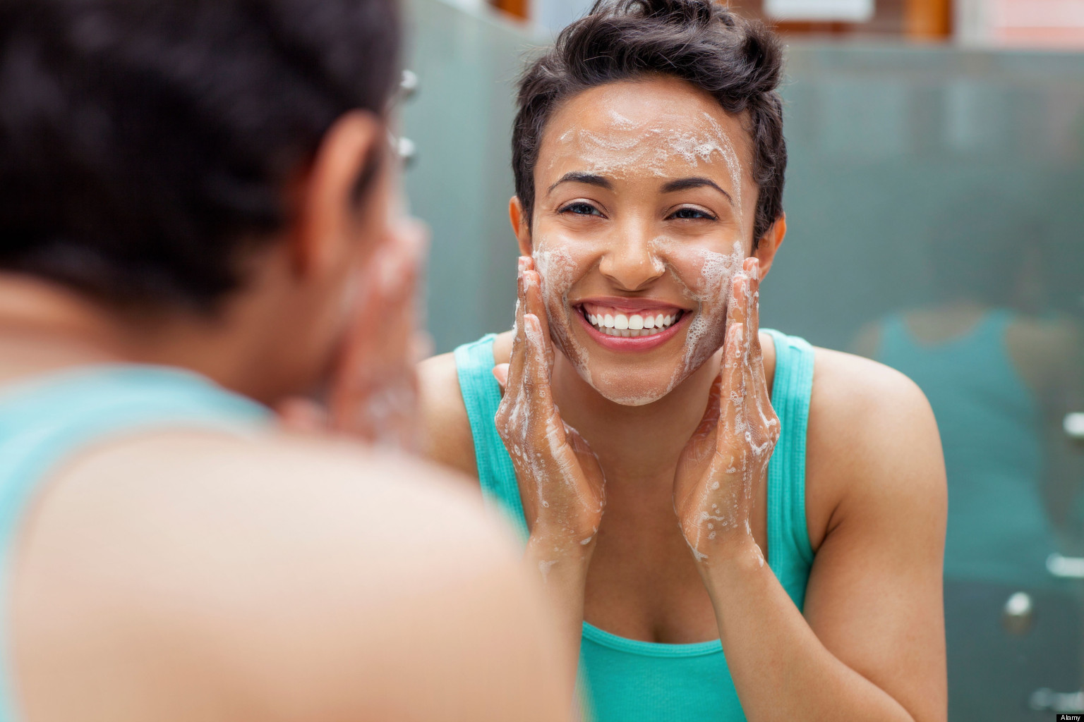 Woman Washing Face 10 Oily Skin Care And Makeup Products To Use This Summer  Her Campus
